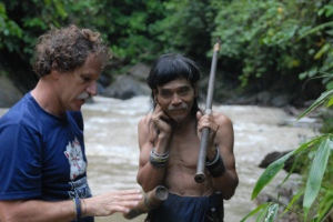Peter Brosius with a Penan man in the Bornean forest. Photo courtesy of Peter Brosius.